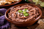 Mexican style refried beans with queso fresco and jalpeno pepper garnish.