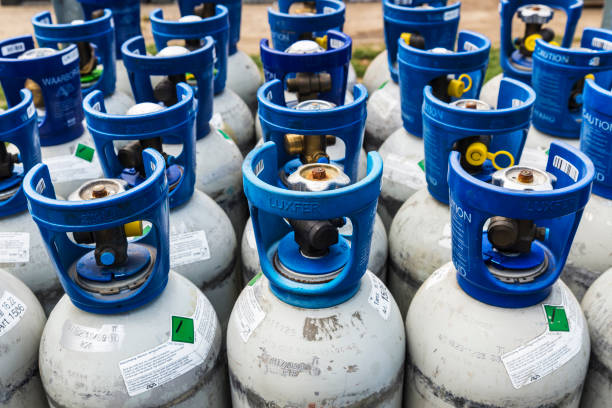 Refrigerant gas cylinders under pressure ready to transport stock photo
