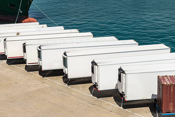 Refrigerated containers Reefer containers waiting to board at the port of Barcelona, Catalonia, Spain vehicle trailer stock pictures, royalty-free photos & images