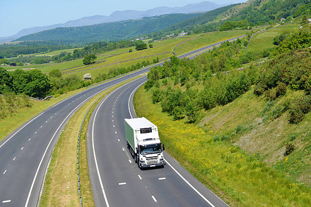 refrigerated rigid goods vehicle on open road - cumbria stock pictures, royalty-free photos & images