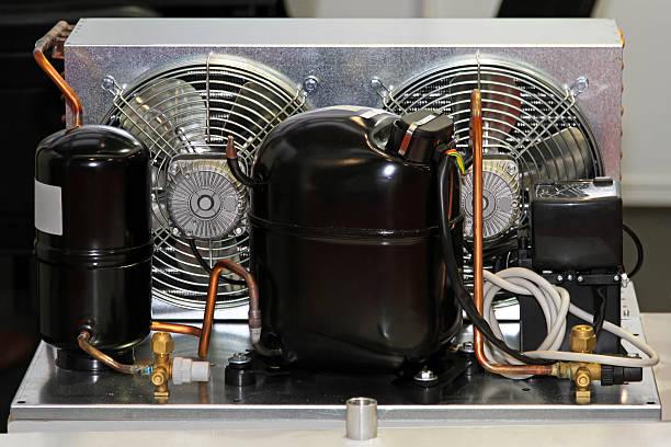 Refrigerator compressor unit Refrigerator compressor pump with air condenser unit compressor stock pictures, royalty-free photos & images