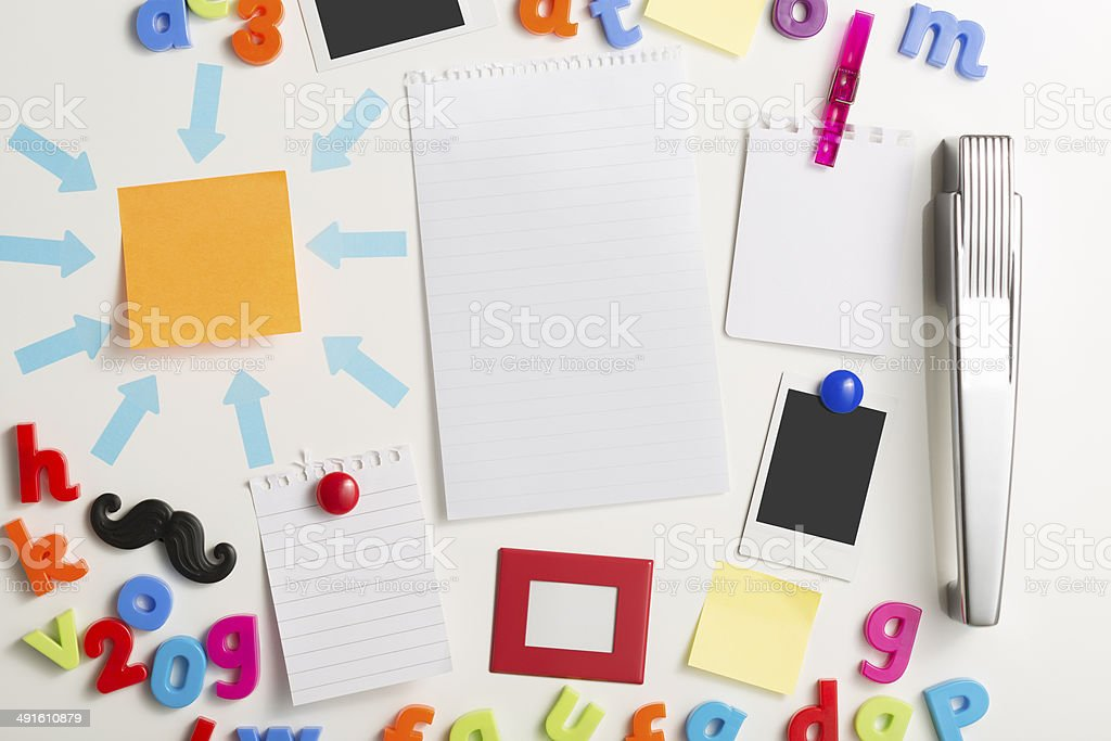 Refrigerator door with blank notes picture frames and prints stock photo