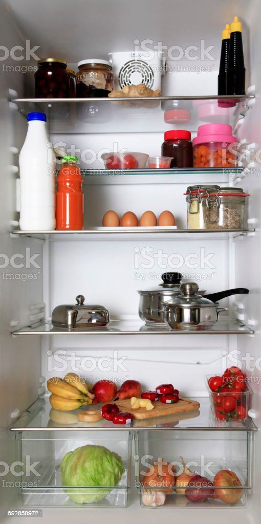 refrigerator, filled with different food stuffs stock photo
