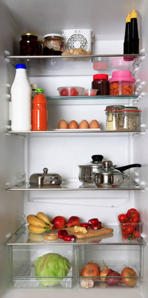 refrigerator, filled with different food stuffs - onion juice stock photos and pictures
