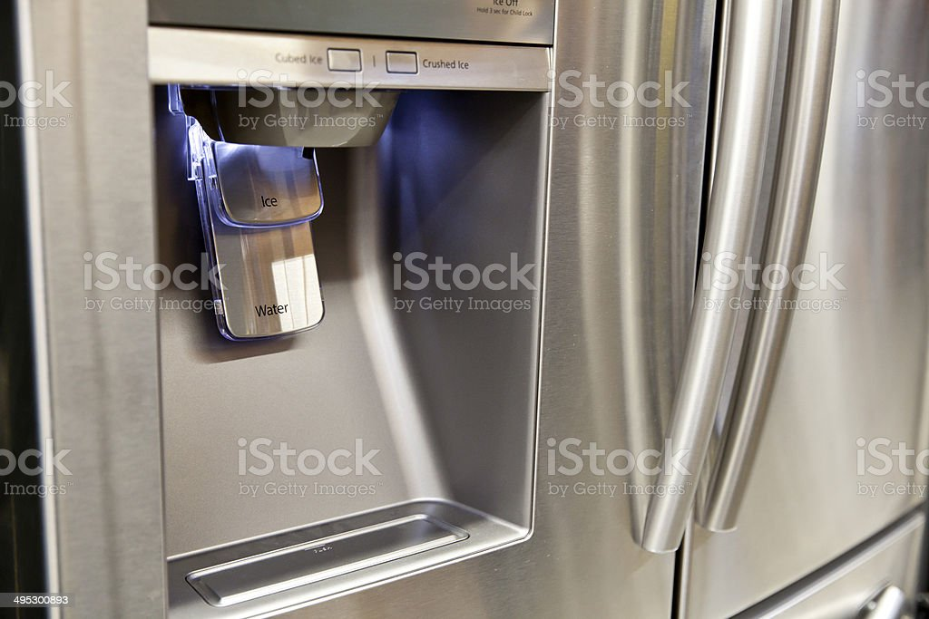Refrigerator Ice and Water Dispenser stock photo