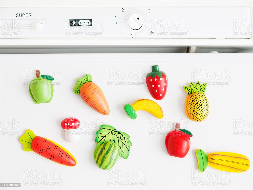 Refrigerator magnets shaped like fruit stock photo