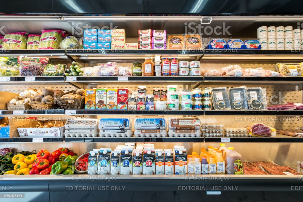 Refrigerator shelves in a grocery delicatessen store stock photo
