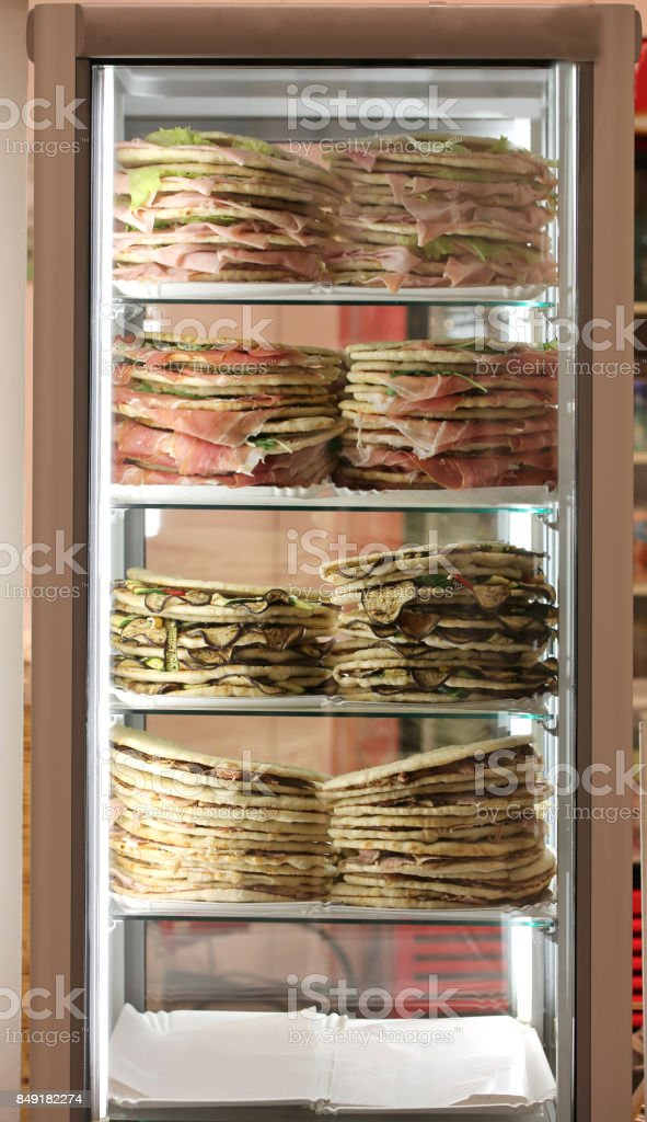 Refrigerator with lots of stuffed sandwiches called Spianata or stock photo