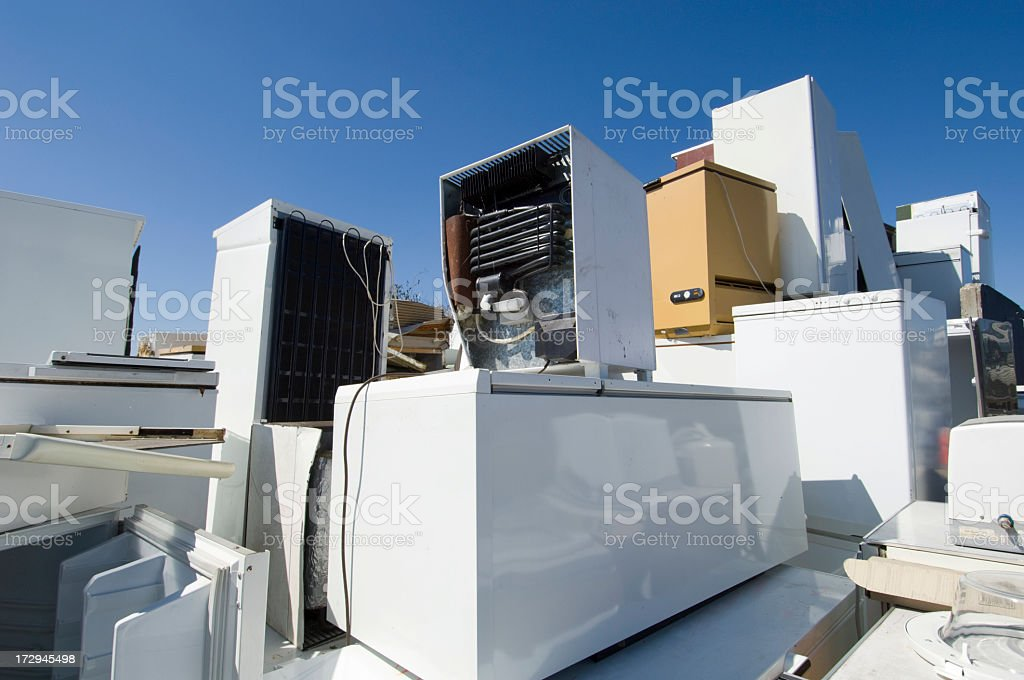 Refrigerators Piled Up Waiting To Be Recycled or Scrapped. stock photo