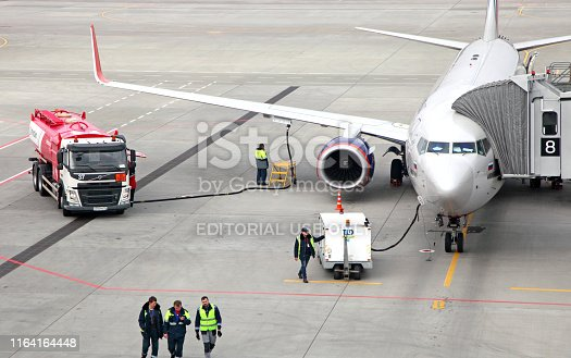 Rostov-on-Don, Russia - April 30, 2019: Refueling the aircraft from the tanker vehicle at the Rostov airport Platov.