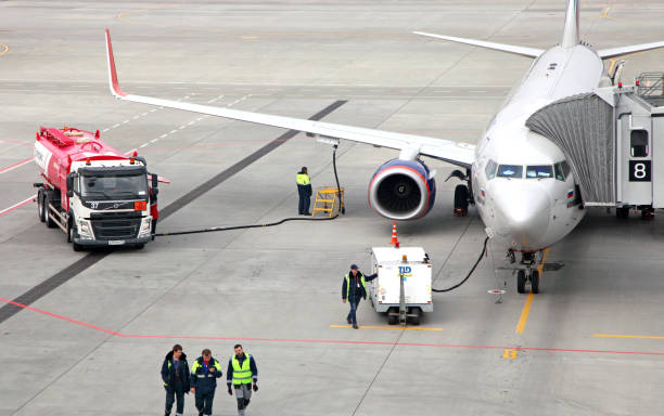 Refueling aircraft from tanker vehicle stock photo
