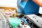 istock Refueling and pouring oil into the engine motor car. Energy fuel concept. 1005398744