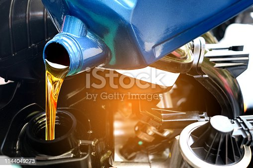 Refueling and pouring oil quality into the engine motor car Transmission and Maintenance Gear .Energy fuel concept.
