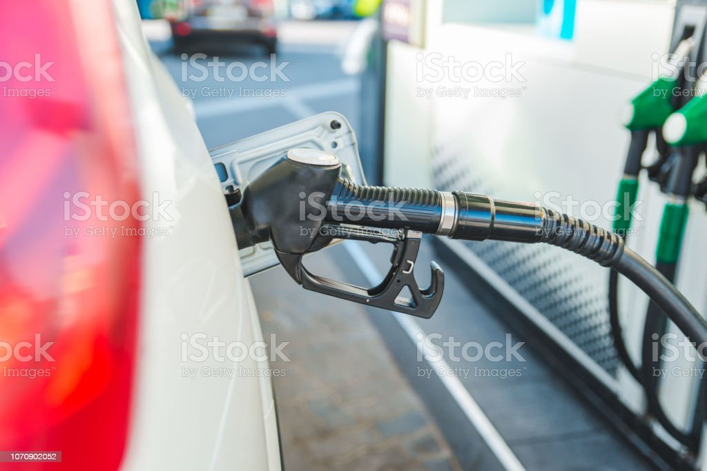 refueling car at gas station. ready for long road trip concept