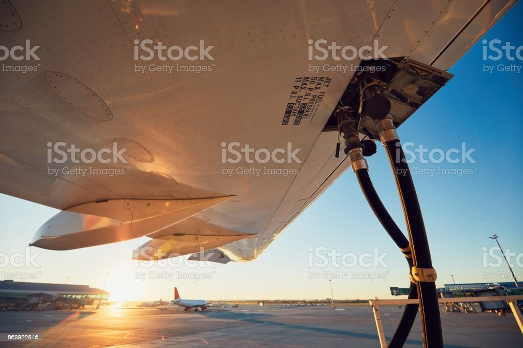 Refueling of the airplane stock photo