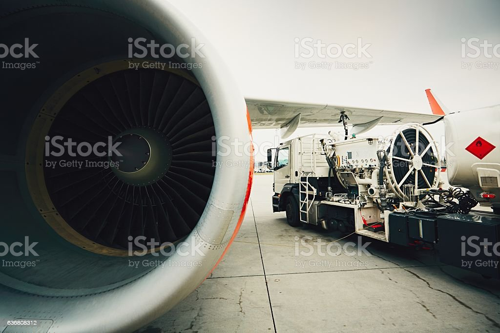 Refueling of the passenger plane stock photo