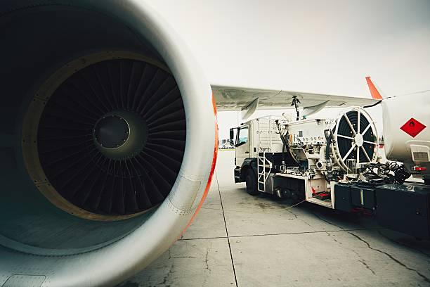 Refueling of the passenger plane stock photo