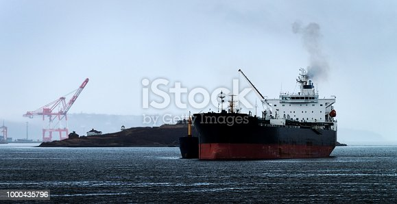 An oil tanker is refueled in Halifax harbor.