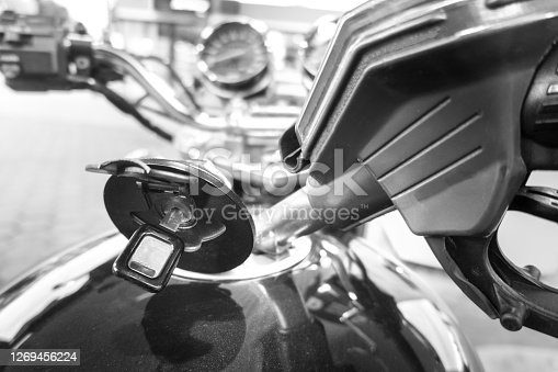 Refueling the motorcycle at the gas station