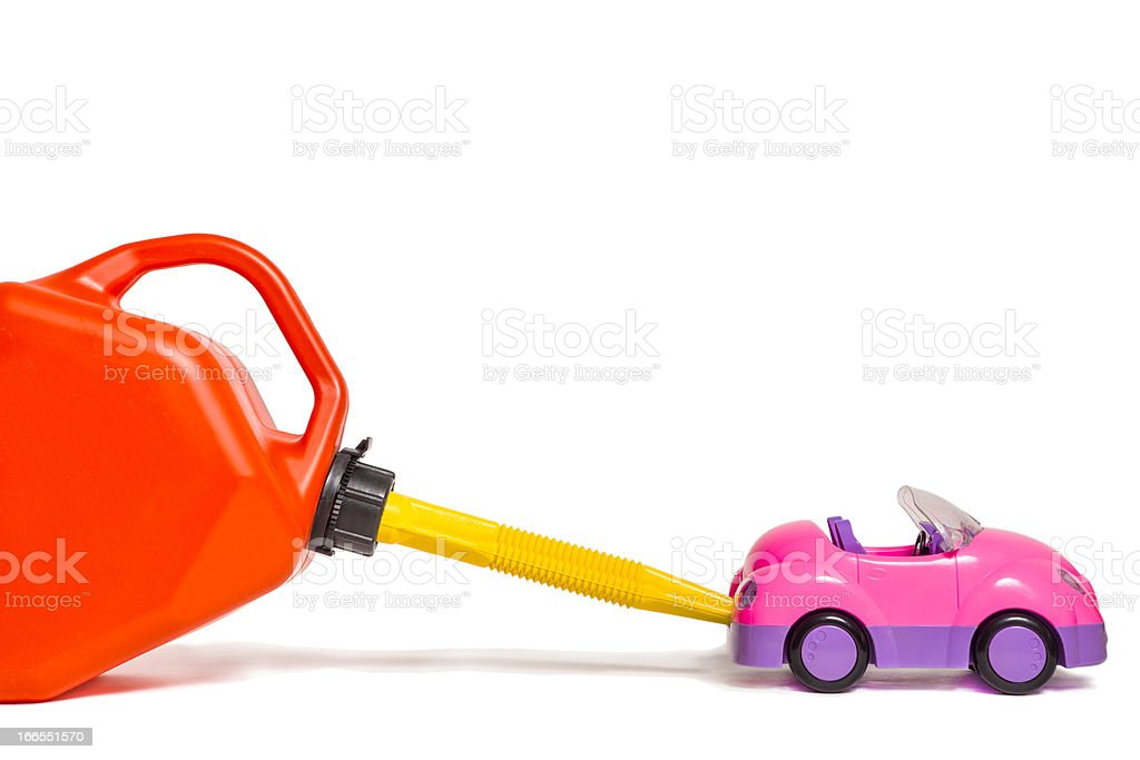 Refueling toy car with plastic gas tank. stock photo