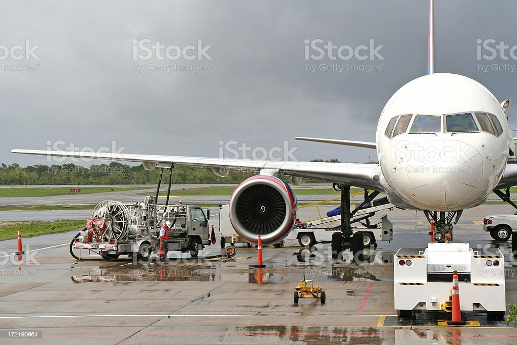 Refuelling an airplane on the airport # 1 stock photo