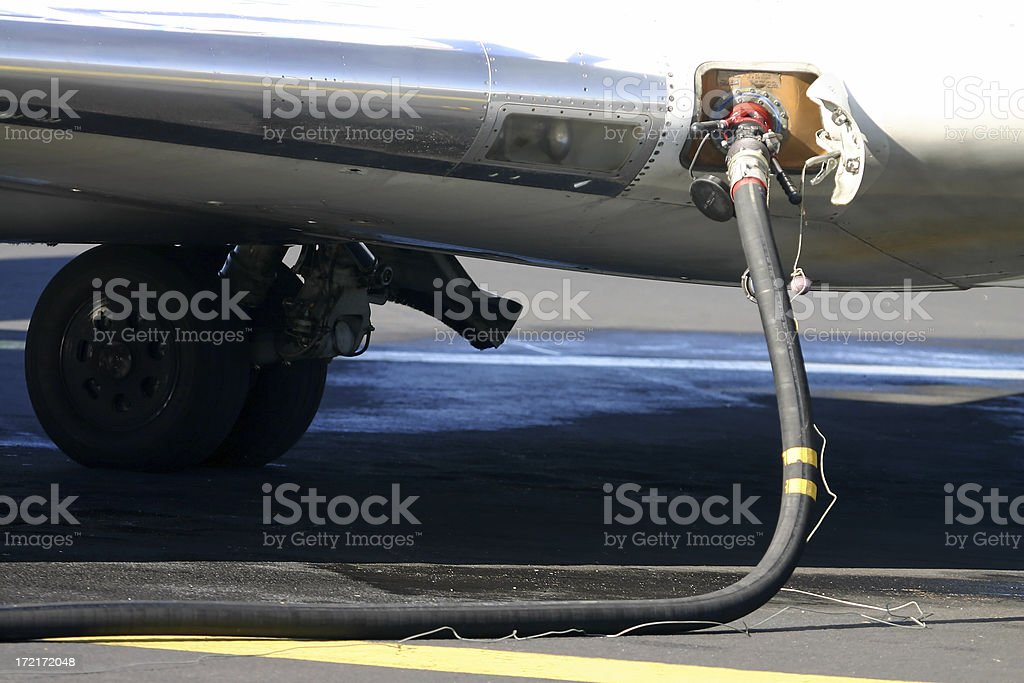 Refuelling the airplane's tank stock photo
