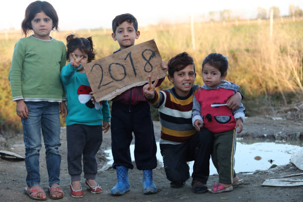 2018 refugee camp syria - kids showing paper stock photo