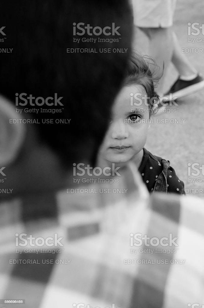 Refugee girl recovering from chickenpox stock photo