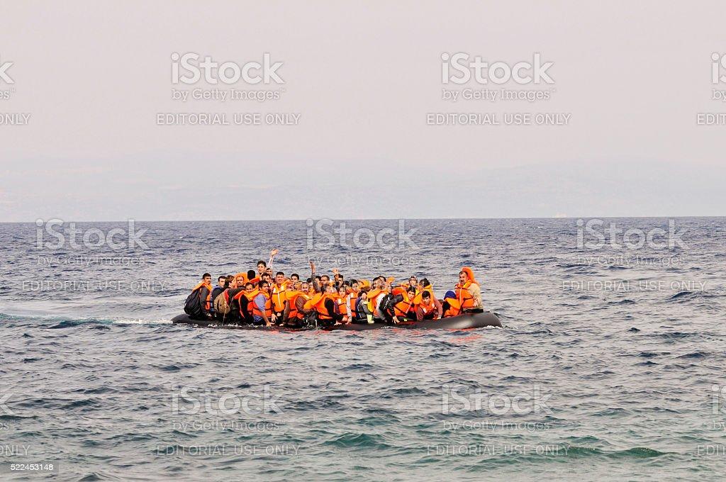 Refugees arrive at Greek island Lesvos stock photo