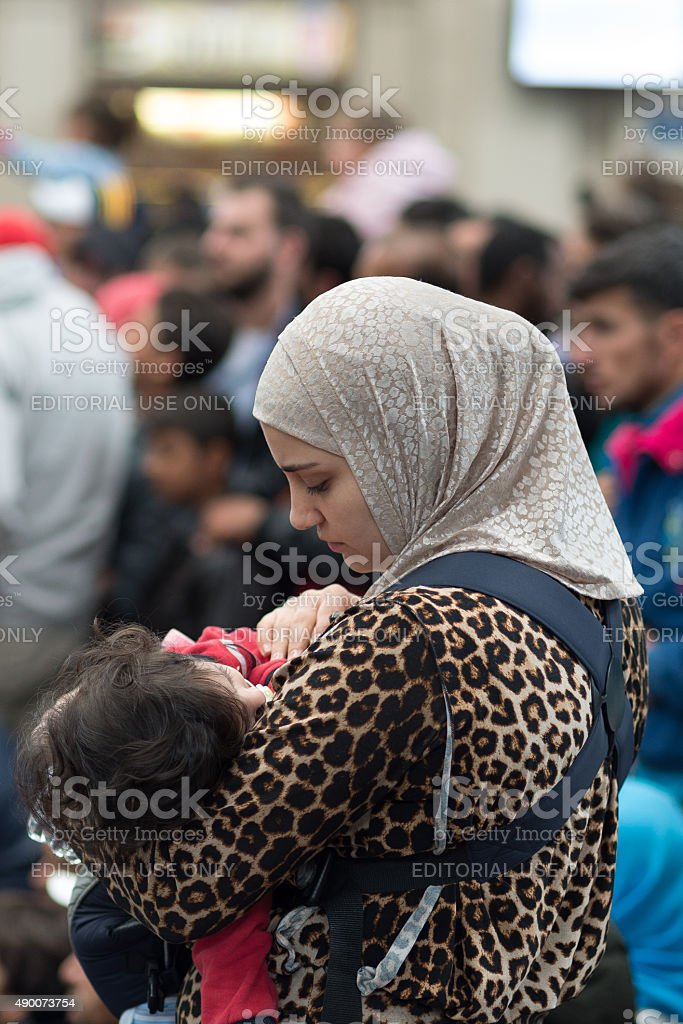 Refugees in the Keleti train station structure of Budapest city stock photo