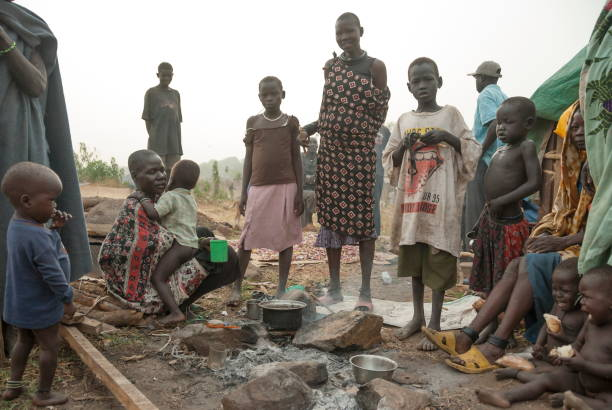 Refugees prepare coffee for breakfast in displaced persons camp in Juba, South Sudan. stock photo