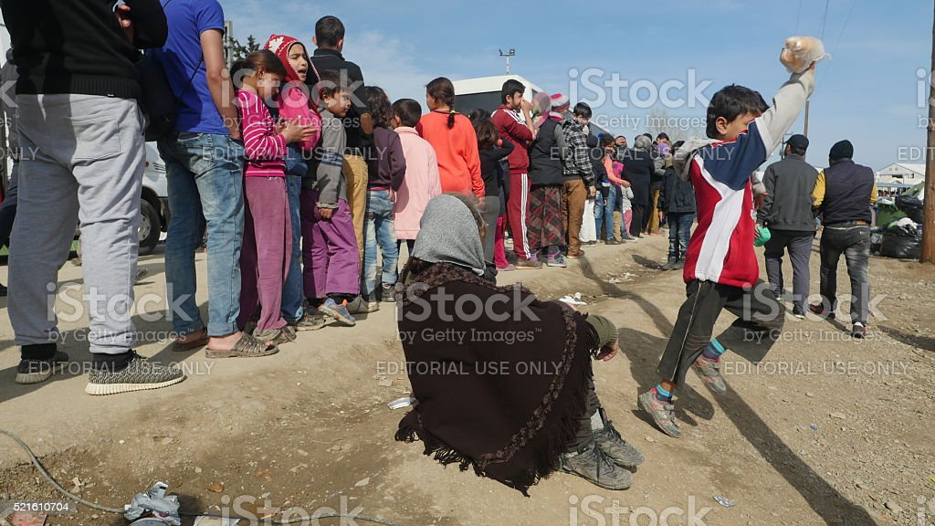 Refugees Wait In Line At A Food Distribution Point Stock Photo
