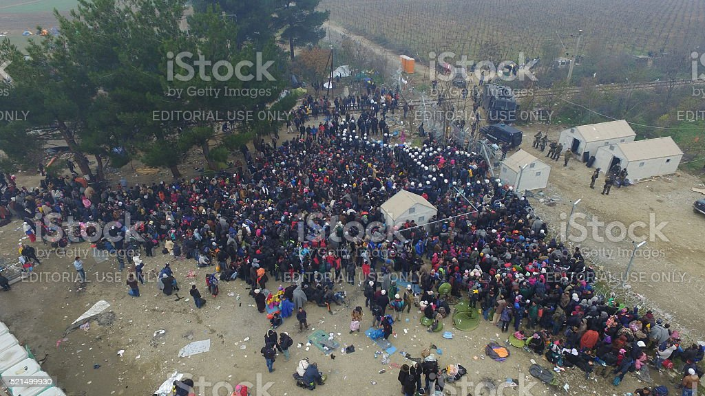Refugees wait to enter Macedonia from Greece stock photo