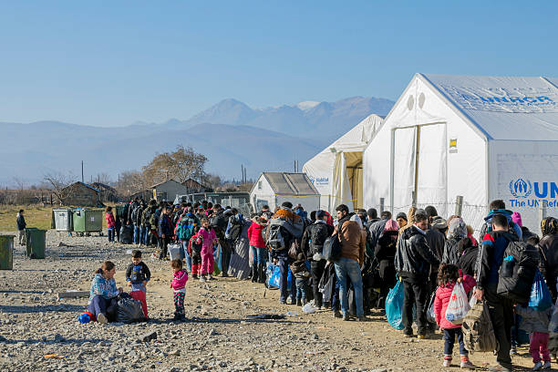Refugees waiting for registration at the Macedonian Border stock photo