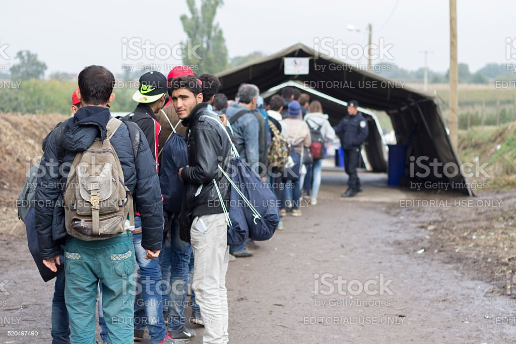 Refugees waiting to cross the Serbo-Croatian border stock photo