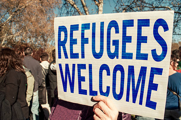refugees welcome - welcome march stock photos and pictures