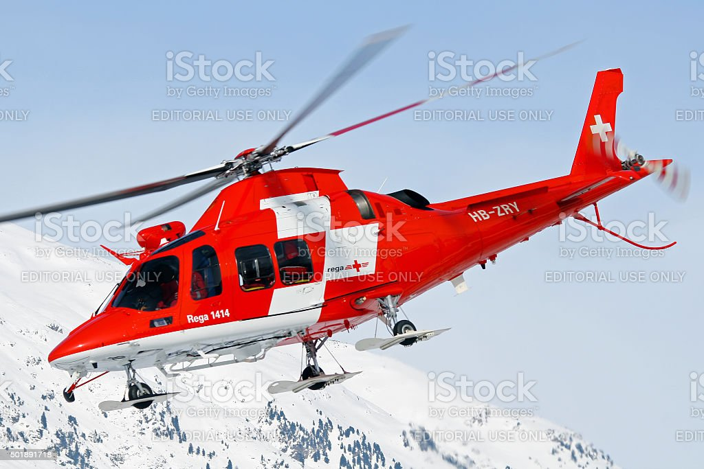 Rega helicopter rescue in Swiss mountains stock photo