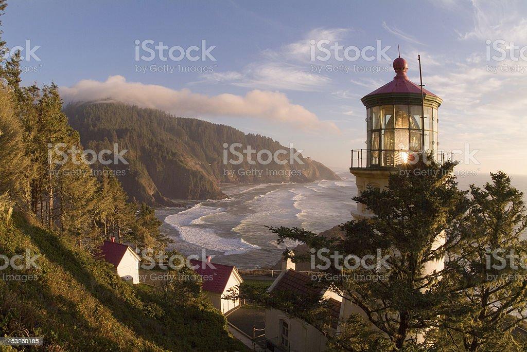 Regal View Heceta Head Lighthouse Shining Across Oregon Coast stock photo