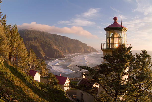 Regal View Heceta Head Lighthouse Shining Across Oregon Coast stock photo