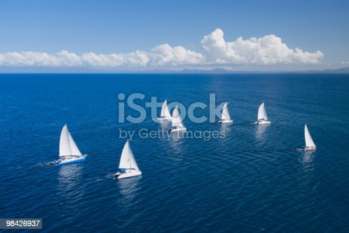 Regatta in indian ocean, sailboat and catamaran. Helicopter view