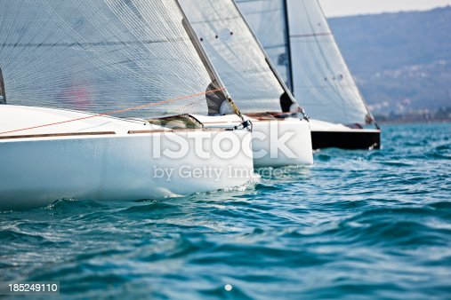 sailboats racing against the wind