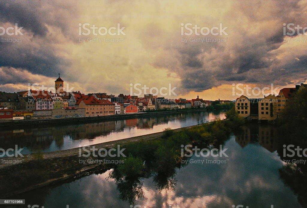 Regensburg at sundown reflected on water. stock photo