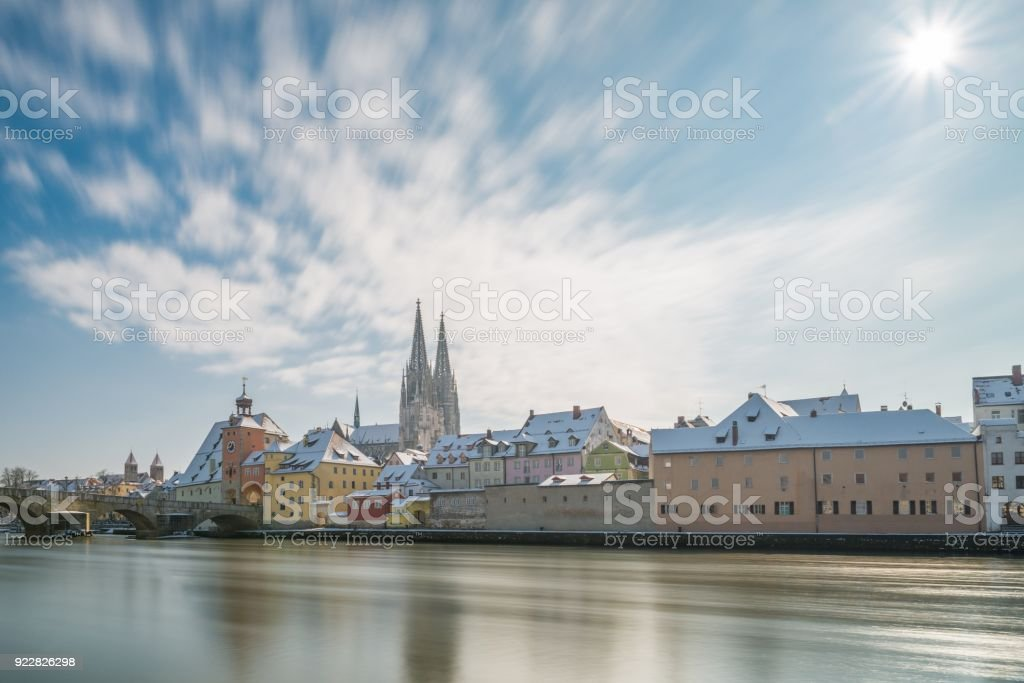 Regensburg at winter with the promenade the Cathedral and the stone bridge, Germany stock photo