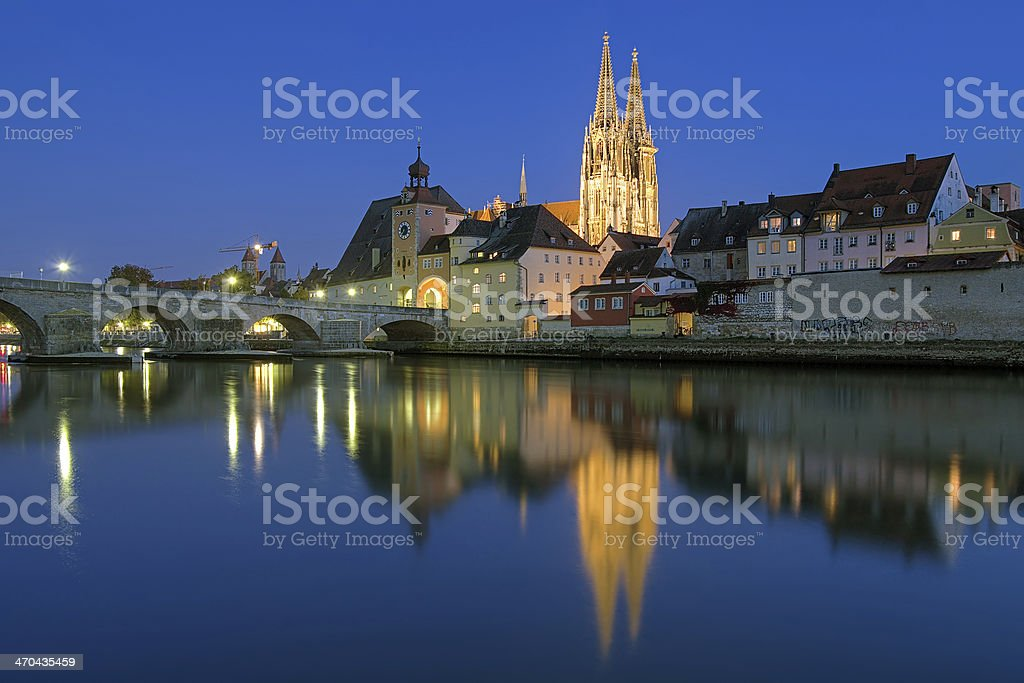 Regensburg Cathedral and Stone Bridge at evening, Germany stock photo