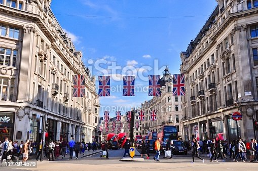London, England, UK – May 17, 2018: Busy foot and vehicle traffic covers Regent Street and Oxford Circus just outside the tube.