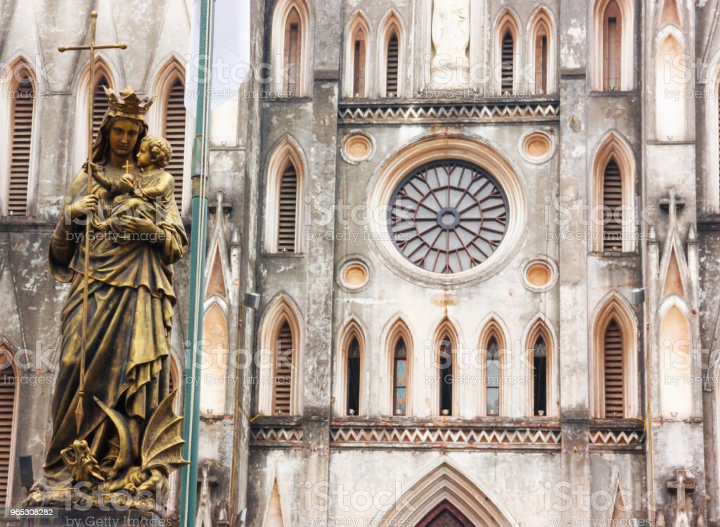 Regina Pacis (Queen of Peace) Statue in front of St. Joseph's Cathedral, Hanoi, Vietnam. St. Joseph's Cathedral is a Neogothic style church that serves as the cathedral of the Roman Catholic zbiór zdjęć royalty-free