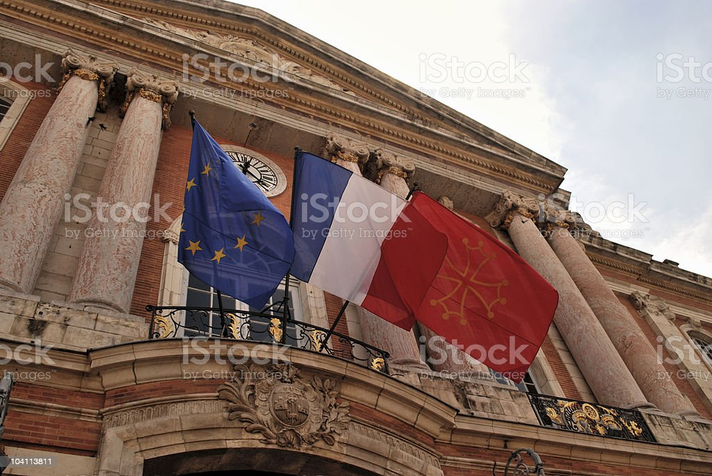 Regional, European and French Flags fly in Toulouse royalty-free stock photo