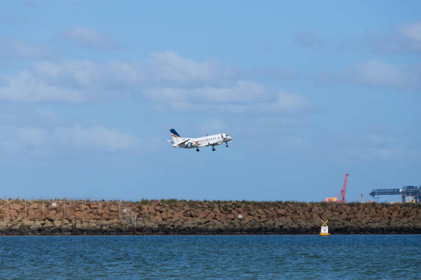 Regional Express Saab 340B Sydney, Australia - February 25, 2019: Regional Express Saab 340B takes off at Sydney Kingsford Smith International Airport. Registration VH-RXN saab stock pictures, royalty-free photos & images