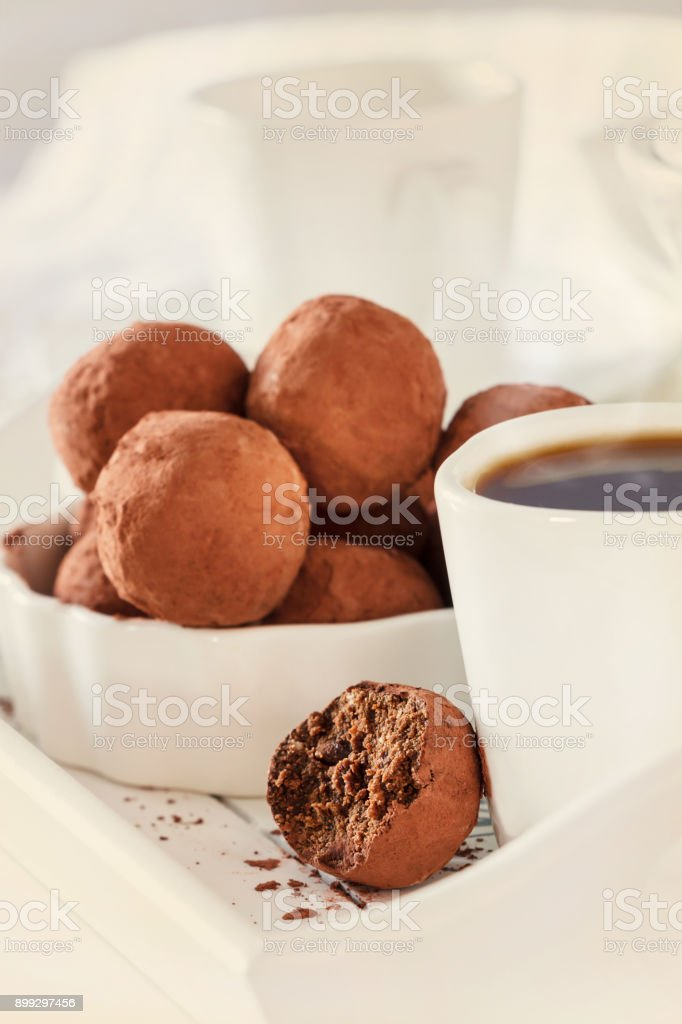 Homemade chocolate vegan truffles. White background. Selective focus.