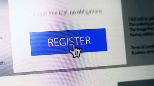 """Register button Stock close up image showing a """"register"""" button on a website with hand shaped cursor enrollment stock pictures, royalty-free photos & images"""